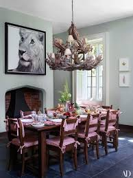 a patrick demarchelier photo of a lion looks over the dining room table set
