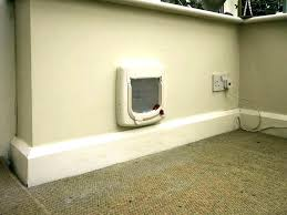 wall mount dog door through the pet installing a cat flap fitter into glass walls doors patio pacific flap wall mount