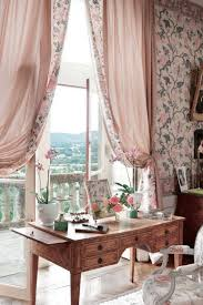 country home office. pink and floral home office with a teak desk country i