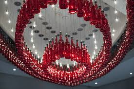 red glass bottle installation with lighting homesthetics