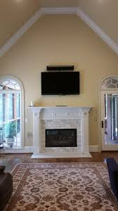 stoll fireplace for a modern family room with a tile surround and white subway tile fireplace make over by atlanta fireplace specialists