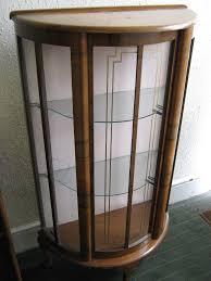 a vintage display cabinet with tambour door