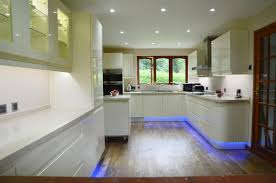 kitchen led lighting under cabinet. led kitchen lighting wooden floor white stained cabinet blue colored light bottom table matble top under