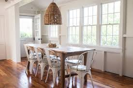 white washed hardwood dining room beach style with window trim metal chairs