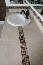 tile bathroom countertop ideas. tiled bath counter top with dark marble accent tile. #tile countertop #marble # tile bathroom ideas c