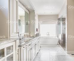 Large Bathroom Large Bathroom In Luxury Home With Sink Bathtub And Cabinets Stock