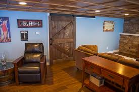 i recently built a rustic sliding barn door for our finished basement and wanted write this article to show you how to build a sliding barn door