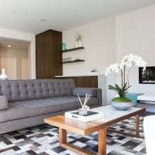 Mid century living room furniture Modest Midcentury Modern Living Room With Tufted Sofa Hgtv Photo Library Gray Midcentury Modern Living Room Photos Hgtv