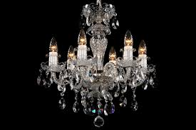 a small six arm crystal chandelier with silver coloured metal