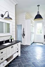 black slate floor tiles. Black And White Cottage Mudroom Is Clad In Dark Slate Herringbone Floor Tiles Lit By A Vintage Bar Pendant Boasts Washstand Finished With