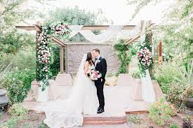outdoor ceremony wooden backdrop arch ds fabric pink flowers romantic soft elopement wedding las vegas kristen