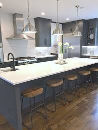sustainable9 home tour charcoal gray kitchen cabinets with white cambria quartz counters and