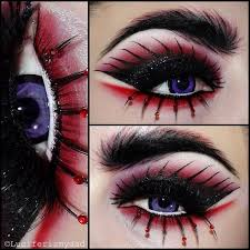 creative black and red fantasy eye makeup with red crystal accented lashes inspired by daenerys targaryen s