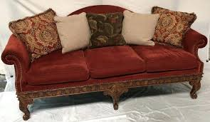 hand carved sofa upholstered image 1 wood table on tufted brown fabric sofa with carved gold wood accents indian furniture