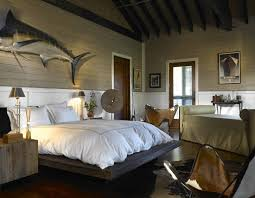 mid-sized eclectic master bedroom with dark hardwood floors and beige walls  would become quite