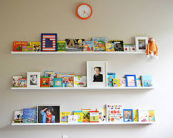i also decided to add some photographs and digital art prints along with the books to the shelves