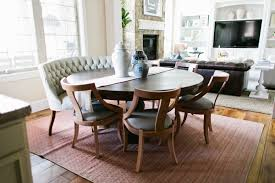 round dining table. White Wall Paint Color For Small Apartment Dining Room With Large Rugs Under Unique Wood Chairs Furniture And Stone Around Fireplace Ideas Also Using Glass Round Table