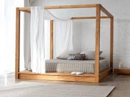 Unique Wooden Four Poster Bed with white furnishings for similar