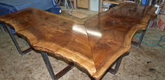 a custom made live edge walnut l shaped desk made to order