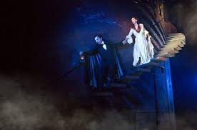 chris mann plays the le role and katie travis is christine in the phantom of
