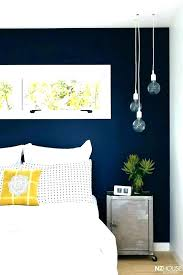 navy blue room decor and yellow living