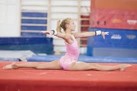 floor gymnastics moves. Contemporary Gymnastics Young Gymnast Doing Splits On Floor Gymnastics Moves O