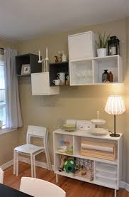 the wall shelves are mounted at different spots on the wall create personality while ensuring adequate storage space for the things edwin and yovanna need adequate storage space