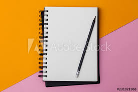 Empty Spiral Notebook With White Pages On A Multicolored Background