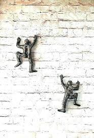 outdoor wall sculpture outdoor wall sculpture sculptures metal the delightful hanging miniature climbing man art by