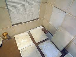 dear tim the 8 inch by 10 inch wall tiles in my bathroom are bulging out in places i pushed on them and they moved further investigation revealed many