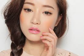 orange blush is a le of the korean beauty look it adds a pop of color to a very simple look to achieve this look simply dab a little bit on your