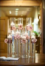 Mirror Tiles For Table Decorations Floating candles wedding idea use different heights for vases with 62