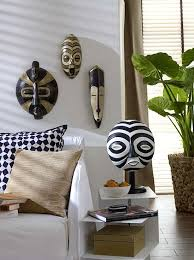 Painted wooden masks in an Africa-inspired living space