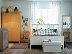 photo of bedroom furniture. a light medium sized bedroom furnished with white bed for two combined bedside tables photo of furniture