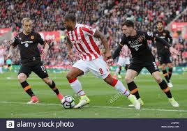 Stoke City's Glenn Johnson and Hull City's Andrew Robertson and Kamil Stock  Photo - Alamy
