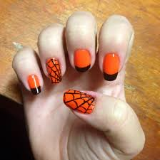 Halloween nail art Neon orange with black tips and a few spider ...