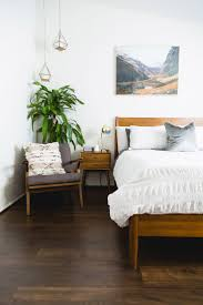 best best mid century modern bedroom ideas with white bedding and armchair plus plants also wall art with mid century modern bedding