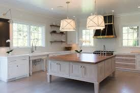 square kitchen island with white pleated drum pendant lights