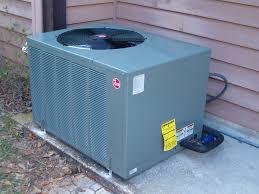 rheem air conditioner reviews. close-up image of a rheem hvac unit. air conditioner reviews e