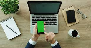 green office desk. businessman using his smartphone with green screen scrolling news checking office desk r