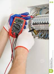 electrician check voltage in electrical fuse box stock photo how to check fuse box car download electrician check voltage in electrical fuse box stock photo image of cable,