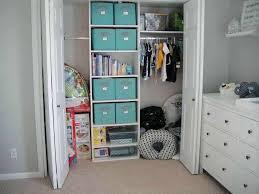 closet storage units white finished wood closet organizer design with several blue box storage units closet