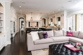 ornate open white space shares kitchen and living room featuring l shaped sectional