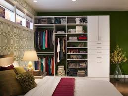 small master bedroom closet design ideas with unique wall art and green paint color also using contemporary table lamps