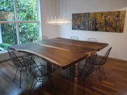 wood slab dining table dining room contemporary with lights metal dining chairs modern icons pendant