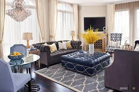 luxurious living room with classic sofa set and armchairs also big windows with sheer white and