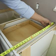 measuring tape over cabinet frame