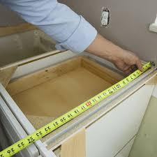 measuring tape over cabinet frame