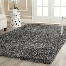 cool gray rugs with and beautiful wood floors along white vase sofa glass door rug