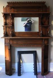 antique ornate wood fireplace surround